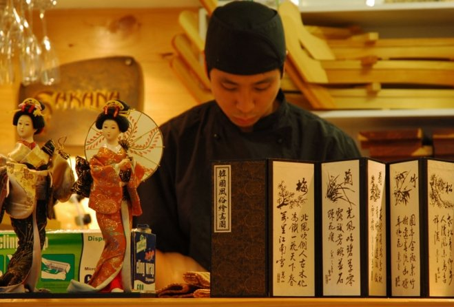 Japanese waiter inside Sakana restaurant in Clayfield