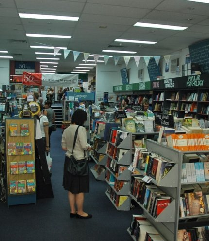 People browsing books inside the American Bookstore in Brisbane