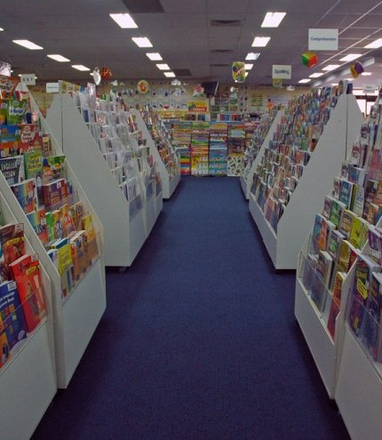 Rows of educational books and toys inside Edsco in Kedron