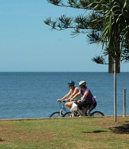 People on bikes on bike path in Redcliffe