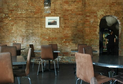 exposed brick inside restaurant dining area