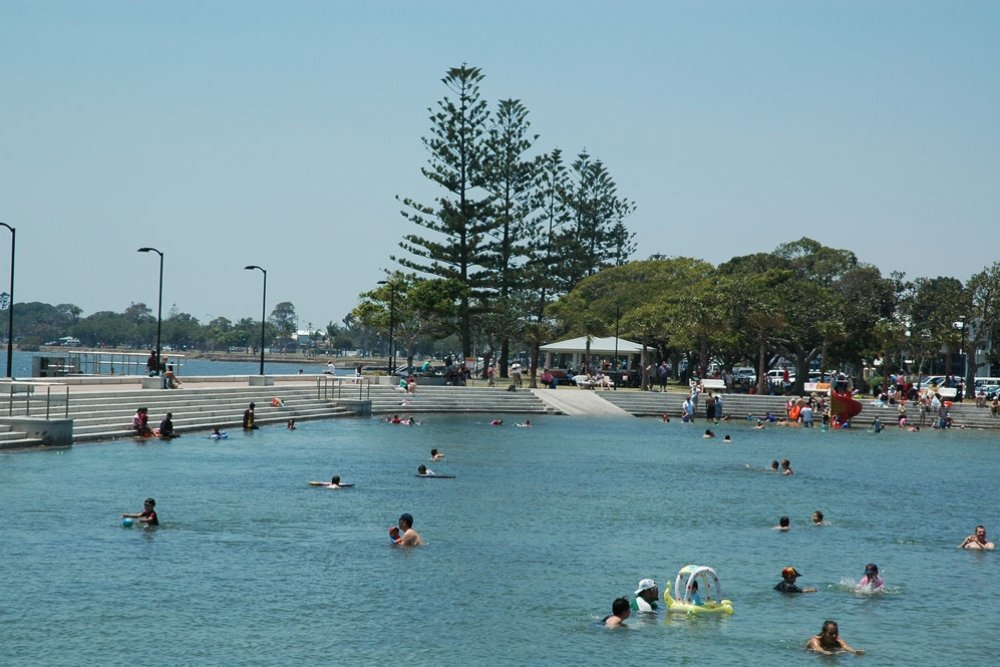 People swimming in the Wynnum Wading Pool in summer