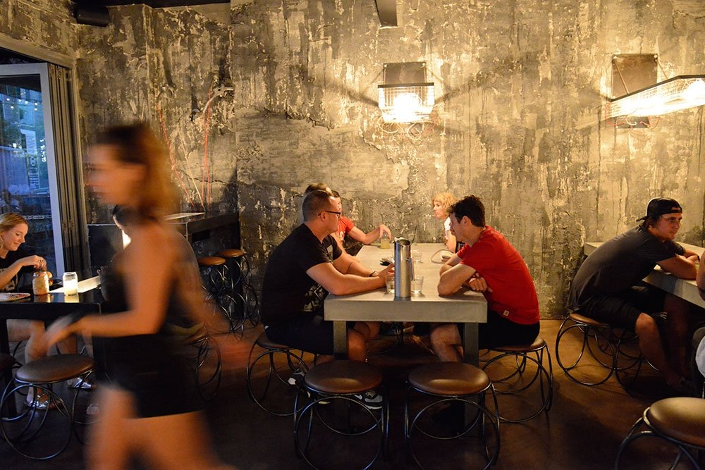 People sitting at tables inside Ze Pickle Bar in Fortitude Valley