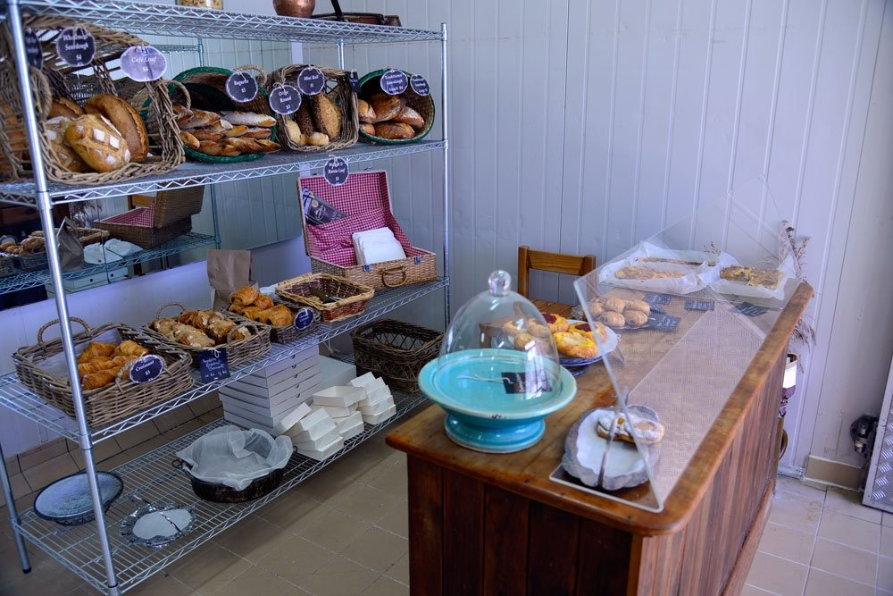 Bread and pastries displayed on counter inside Crust and Co.
