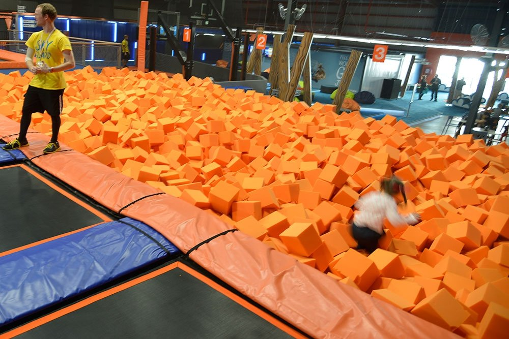 Sky Zone MacGregor girl jumping into foam basin